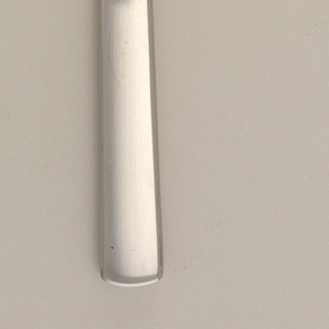 Blade joining straight handle.
