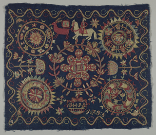 "Dark blue wool ground embroidered in coarse outline and filling stitches in polychrome wool yarns. The large central medallion has an interlace pattern inside a stylized floral wreath.  Above this are a reindeer and horse and rider, and below it a pendant framing the initials ""JHJD.""  A medallion in each corner contains a stylized floral pattern, and there is a continuous scrolling border around the four sides. The date 1796 appears near the lower edge."