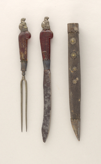 Shagreen sheath for two implements with silver cap and mount on top. Silver flower-shaped appliques with brass rivets on the sides.