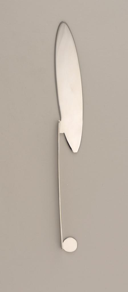 Elongated, flat handles with flat circular terminal. Elongated, elliptical-shaped blade arranged perpendicular to handle.