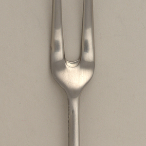 Two long tines and short bowl joining straight shaft extending to handle.