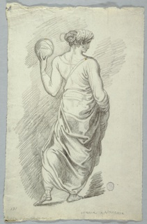 A walking woman, seen from behind, holding a ball in her left hand.