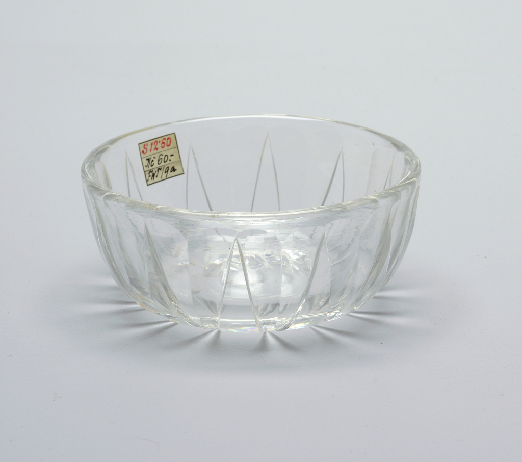 Mouth-blown crystal dish, with cut and polished rim ornaments.