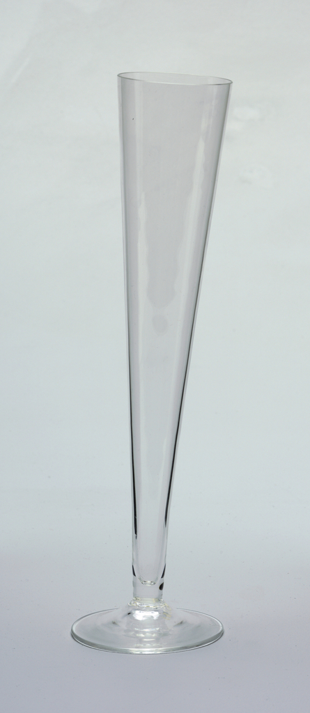 Tall  cone-shaped champagne flute at an asymmetrical tilt