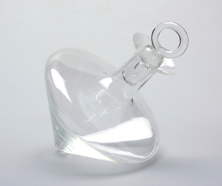 Broad conical decanter with cylindrical neck, flared circular mouth and thick stopper with ring handle. Decanter designed without foot, to rest at angle.