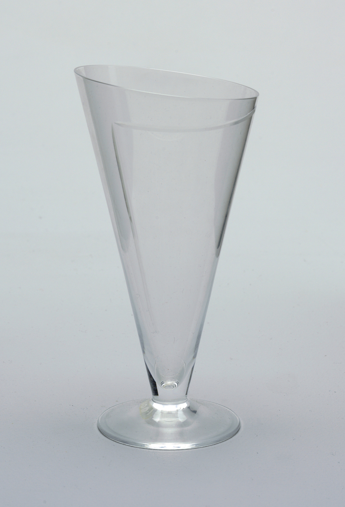 Conical shaped wine glass with asymmetrical top, one line engraved on goblet