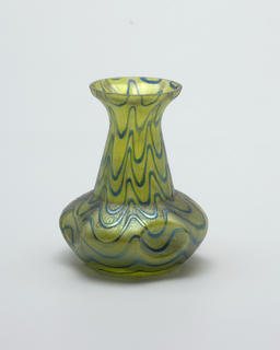 Green glass with blue swirl pattern