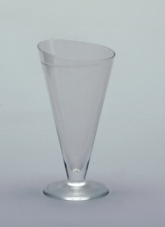 Conical shaped water glass with asymmetrical top, one line engraved