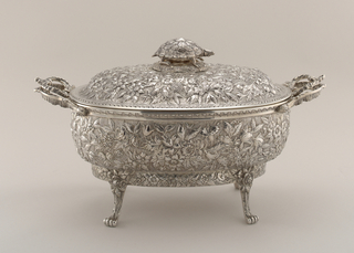 Repoussé and chased with flowers, foliage on a granulated ground, the matching lid with terrapin turtle finial, plain liner with Rococo handles matching tureen handles.