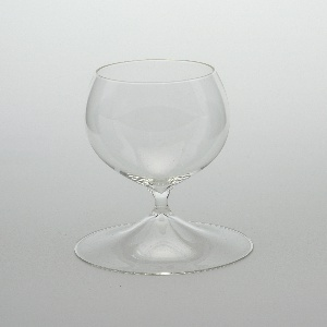 One-piece form comprising ovoid bowl on short stem with broad conical foot.