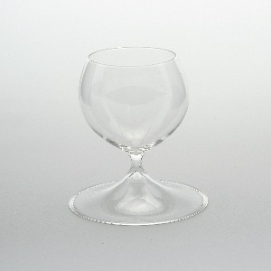 One-piece form comprising small ovoid bowl on short stem with broad conical foot.