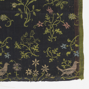 Polychrome plants, animals and birds on dark blue background. One selvage present.