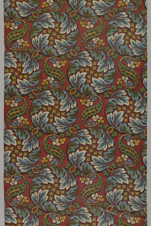 Square offset repeat of a large medallion made up of four curving leaves enclosing small rosettes. Medallions connected by small ovals and spaces between medallions filled with scrolling and curving leaves. Bright strong colors on a deep red ground.