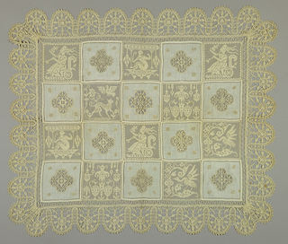 Squares with animals and grotesque figures alternate with squares of fabric with cutwork and needlework filling put together to form a checkerboard pattern. Deep scallop of bobbin lace on the border.