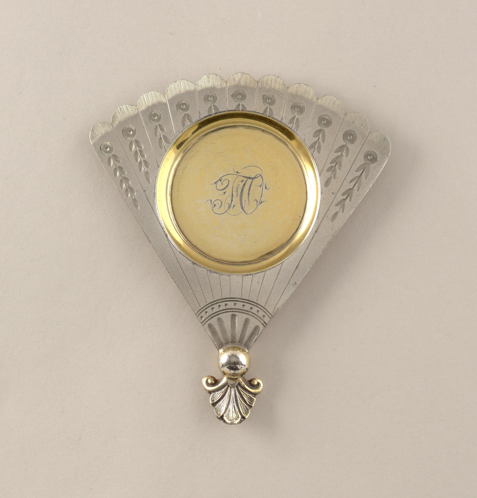 In the shape of a folding fan.
