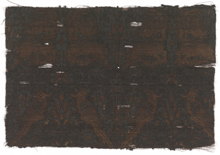 Paired parrots and horned quadrupeds against a background of verdant foliage. Entire piece has been dyed black although it was probable that it was originally in several colors.