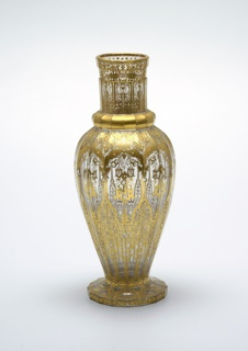 Two vases (a,b) in baluster form with gilt decoration in Islamic style.
