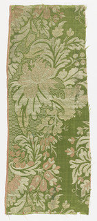 Green silk weave, lampas, satin filed with leaf scrolls and details of checker motifs in twill weave. Large scale floral design.