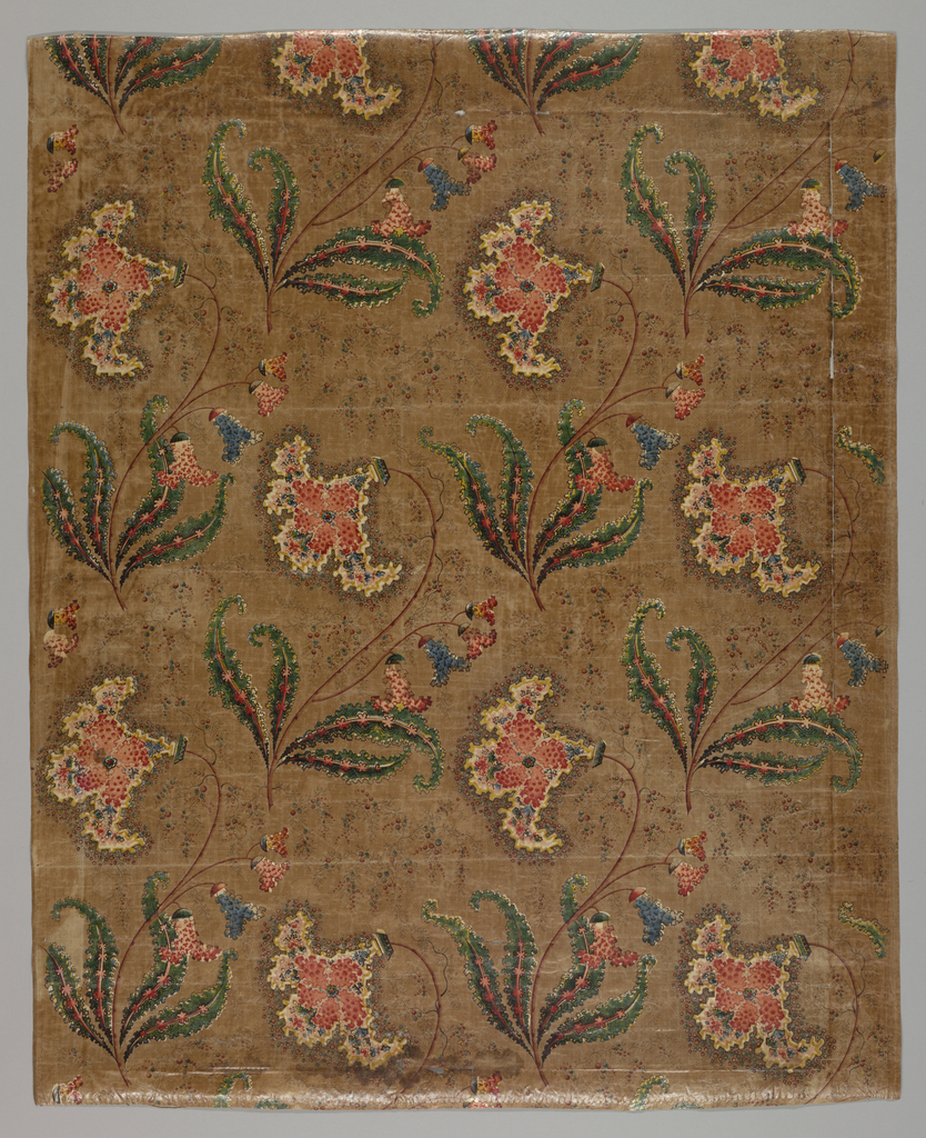 Very fragile fragment of glazed chintz. Fantastic flower design framed by a jagged outline on a brown ground. Printing done by roller and block combination. Green color achieved by printing yellow and blue.