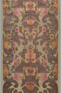 Length of furnishing velvet with scrolls and flowers in the style of the early 18th century. The voided background is broken by short floats of metallic wefts to simulate wear and age. The velvet warp pile is also shaded in a manner that suggests aging. Dark brown, orange, yellow-orange, pink, and blue pile on a cream and metallic foundation.