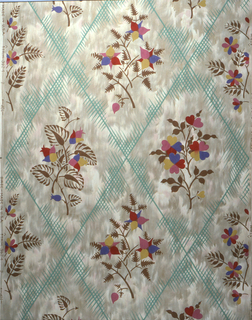 Stylized floral bouquets set within a green diamond trellis pattern. Printed in red, blue, yellow, pink and green on mottled tan background.