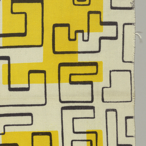 Black maze-like lines and bright yellow shapes that look like jig-saw puzzle pieces.