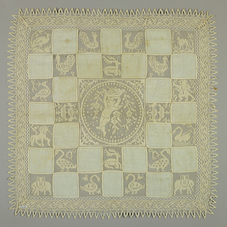 Squares of fabric alternate with squares of birds and animals embroidered on net put together to form a checkerboard pattern. Centered is a medallion with a cupid holding vines. Bobbin lace edge.