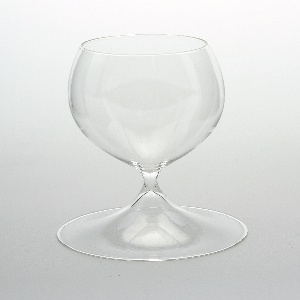 One-piece form comprising large ovoid bowl on short stem with broad conical foot.