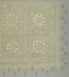 Long rectangular altar cloth of embroidered net squares arranged in two rows. The two alternating motifs are a diamond within a square and a cross within a square. Each square has areas of plain weave cutwork with needle lace fillings and is edged by a band of bobbin lace. Both side and front edges have a band of bobbin lace with knotted tassels in between each scallop.