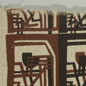 Oatmeal ground printed in two shades of dark brown with large, close-set geometric blocks.