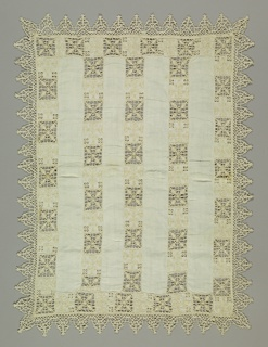 Chalice cover edged by Venetian bobbin lace of elaborate triangles. Cover is ornamented by wide insertion of reticella. Pattern geometric in character.