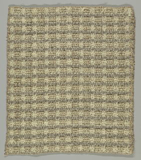 Rough textured gray and white upholstery material with horizontal ridges in high relief and containing hints of gold achieved by alternating groups of thick and thin weft yarns.