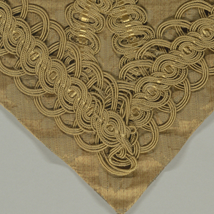 A: Lambrequin of a triangular shaped gold fabric trimmed with 7.5 (3in) gold braid. B: Length of fabric (gold warp, blue weft) with design of oval medallions, urns, scrolled swags, griffons. Vertically symmetrical. C: Piece of same design in blue warp, yellow weft.