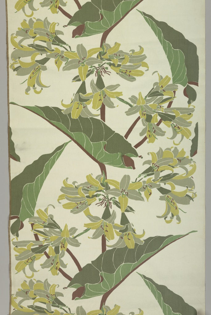 Textile with a design of clusters of lilies and leaves printed in three shades of green, yellow and brown on a white ground.