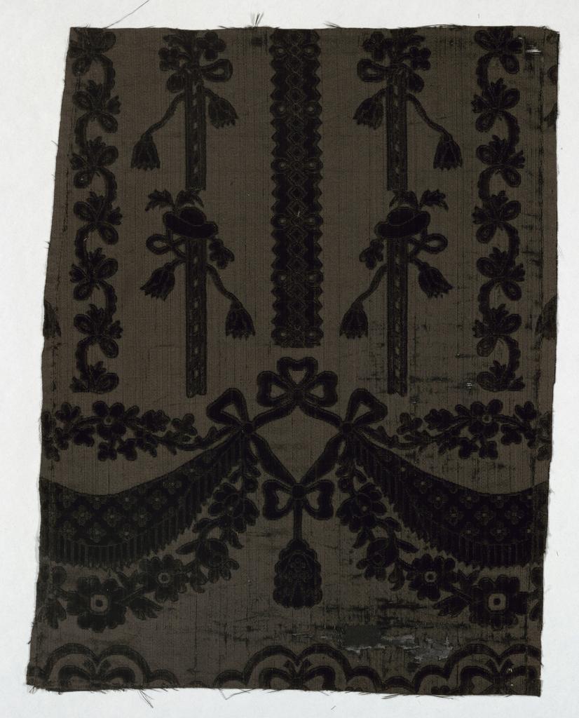 Fragment of black figured velvet in an incomplete design of stripes and festoons.