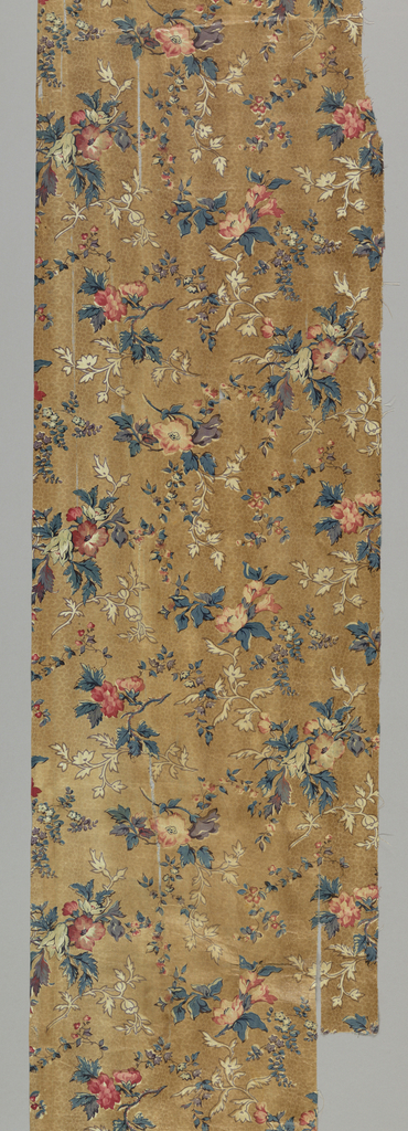 Floral pattern in blue, pink, purple and white on a light brown ground.