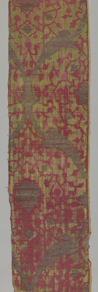 Large-scale cartouches in red, green and metallic. Worn. One selvage.