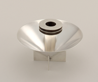 Cone-shaped candlestick with base of cross form and tubular candle holder decorated with three thin discs.