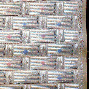 Basket weave pattern, in shades of light brown, with alternating pink or blue dot in center of each rectangle.