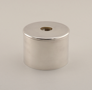 Shiny silver-plated cylindrical sugar bowl with lid containing a hole at the center.