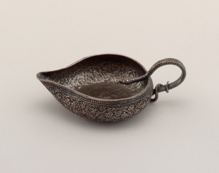 Circular shape with pinched spout and handle in form of snake.