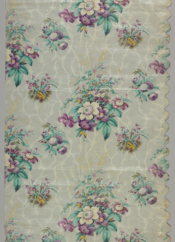 Panel of thin glazed chintz with ground in grey, with naturalistic flower clusters in lavender, rose and blue-green. Background has a streaked or cracked ice effect. Right side scalloped