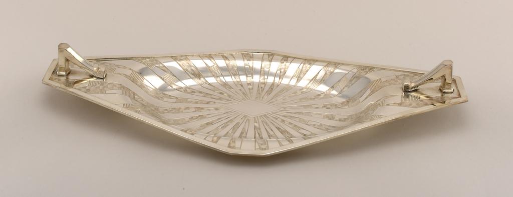 Lozenge-shaped; sunray pattern decoration.
