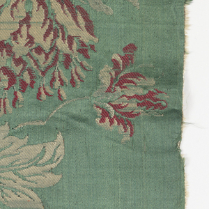 Flowering sprays with bird and butterflies on green satin.