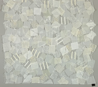 Length of fabric in which squares of various woven and embroidered white Nuno fabrics are machine stitched to a water-soluble base cloth which is then dissolved away, leaving an open ground with 'floating' scraps.