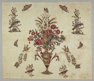 Natural-colored square printed with a central urn of flowers and wheat stalks surrounded by isolated motifs of butterflies, and birds in trees and on sprigs. Printed in black, blue, tan, yellow, and two shades of red.