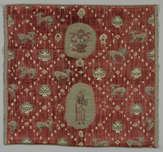 Animals and medallions adapted fom fabrics of the 10-12th C. in aquas, black and metallic on a strie deep red background.