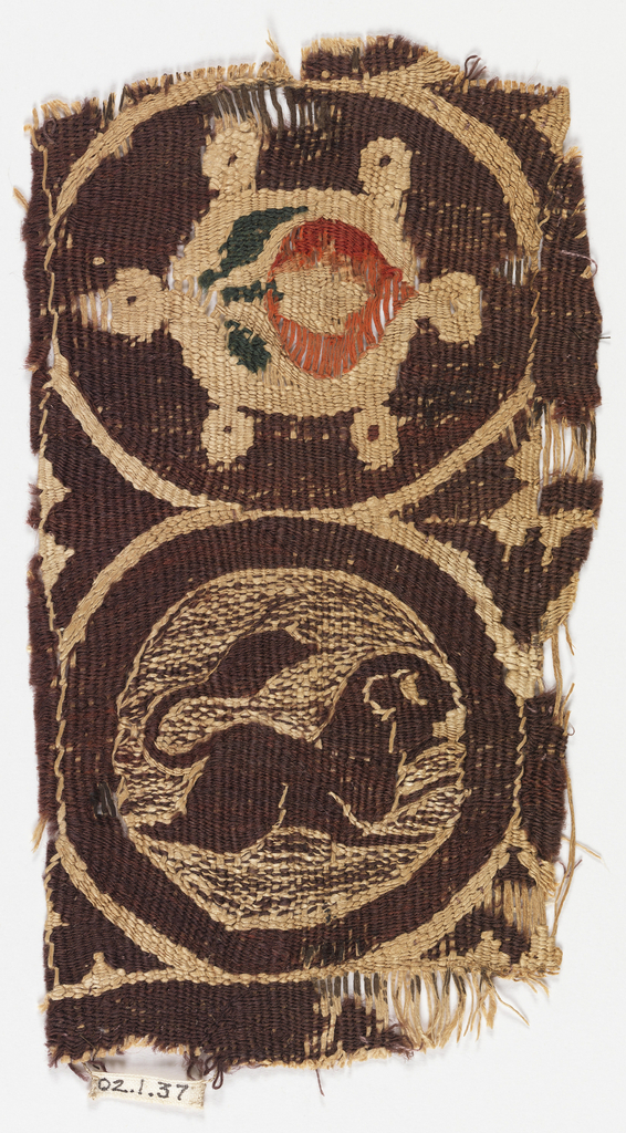 Fragment contains two circles, one holds a running lion, the other something that might be a turtle with a flower on its back.