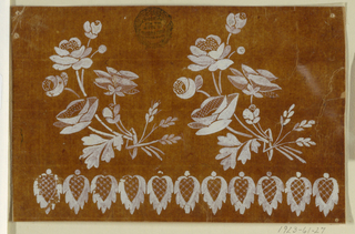 Two bunches of roses which are fastened by ears of grain are shown over a row of lace panels.