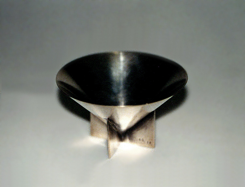 Cone-shaped bowl with base of cross form.